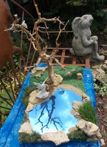 Fun Fairy Garden Done with Granddaughter from Fossils we found together.