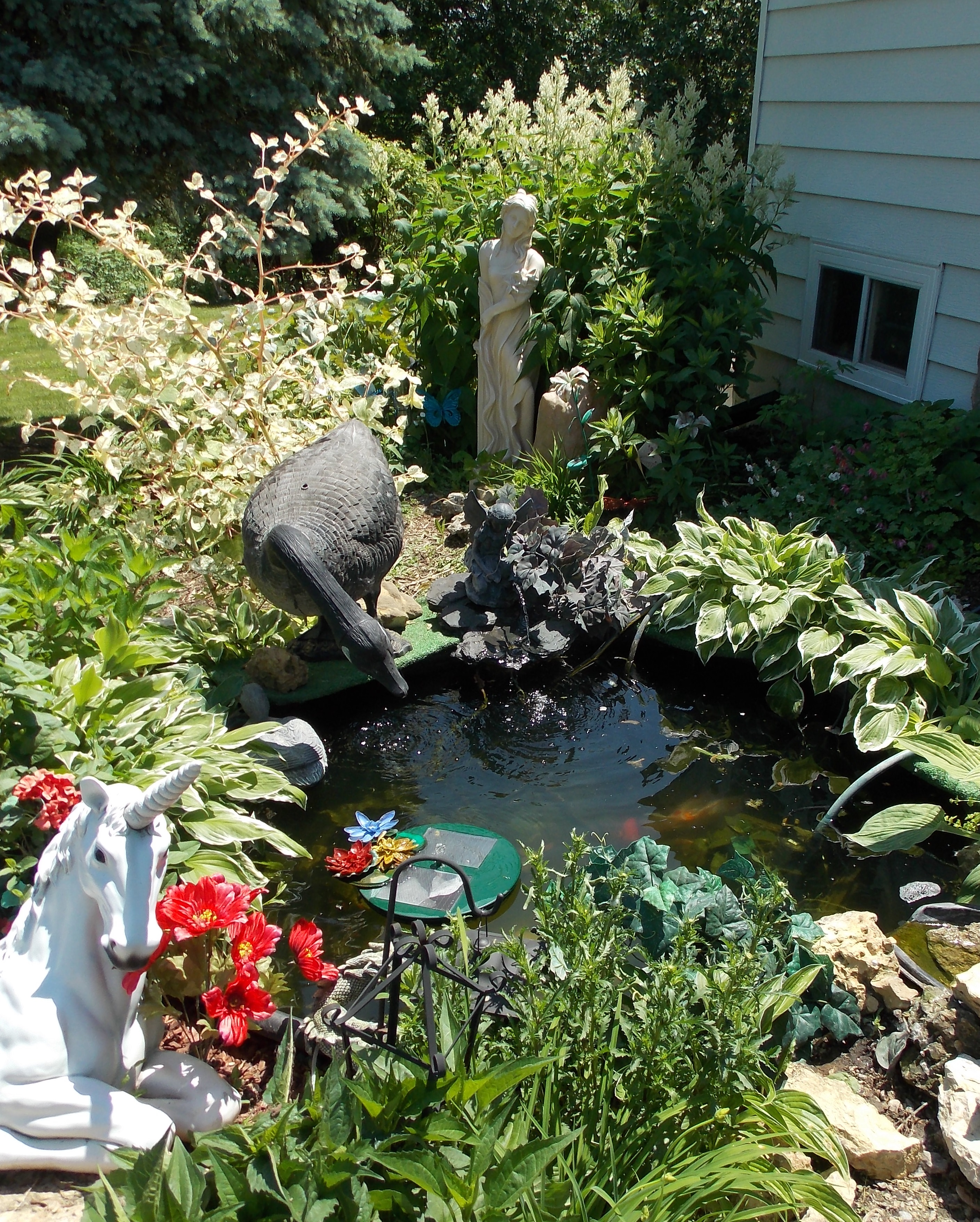 Permaculture sustainable living tour bluff country fossils for Koi pond builders mn