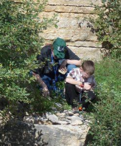 PJ investigating a fossil.